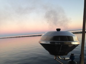 Smoking tuna steaks on the grill in Oriental harbor